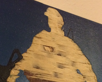 Wooden base is revealed underneath the soldier's silhouette